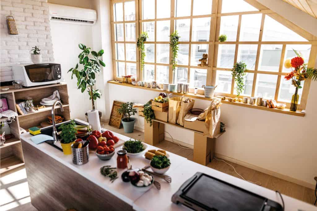 Modern kitchen with ingredients on kitchen counter, vegetables and utensils. living window treatment