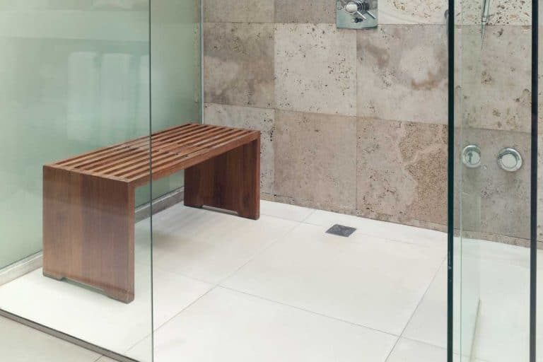 Modern rain shower with a wooden bench, What Is The Best Material For A Shower Bench?