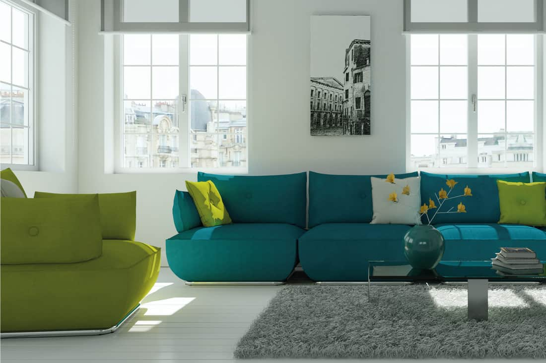Modern white living room interior design with green and blue sofa