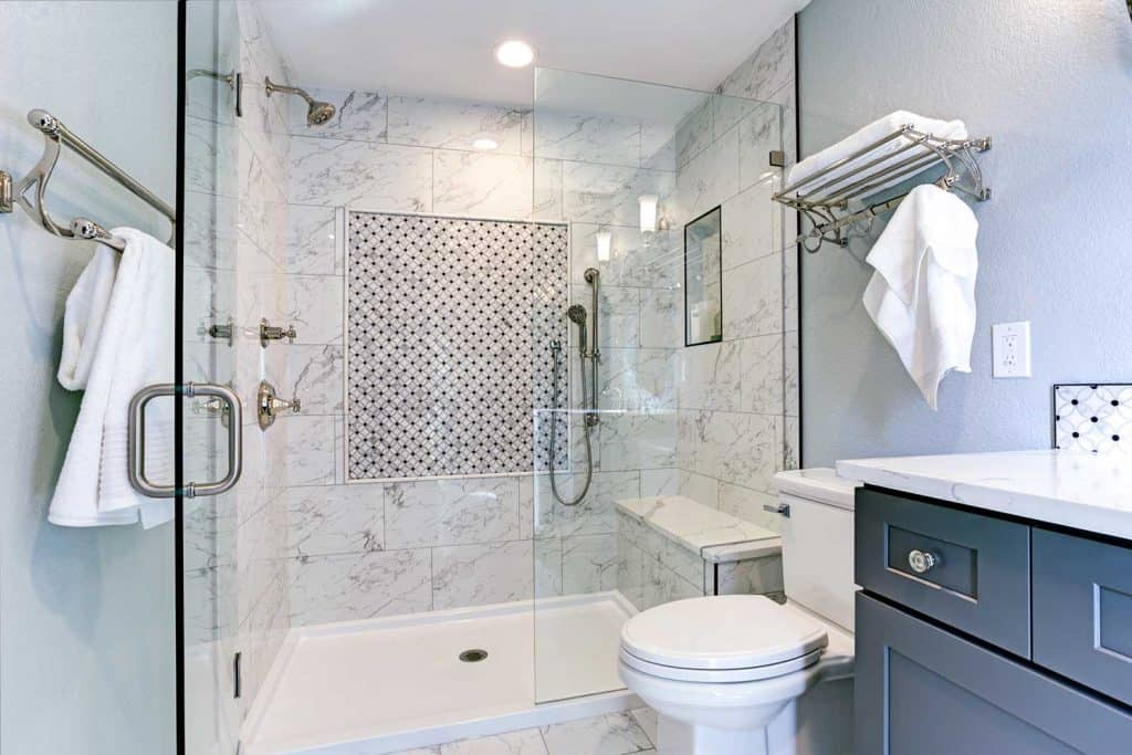 New bathroom design with marble shower surround and mosaic accent tiles