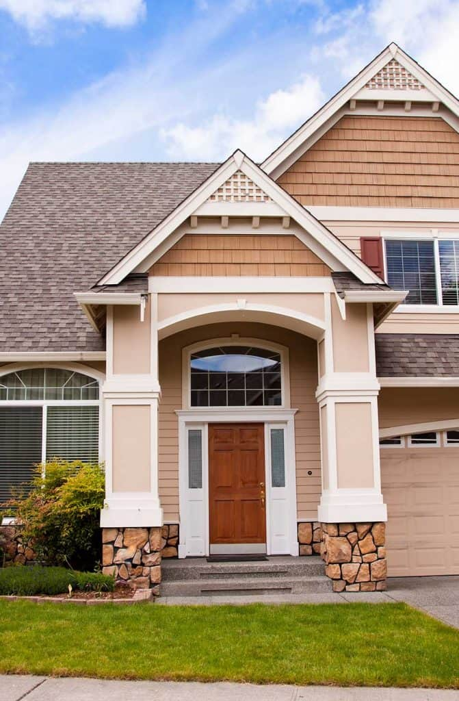 New beautiful suburban luxury house at sunny day