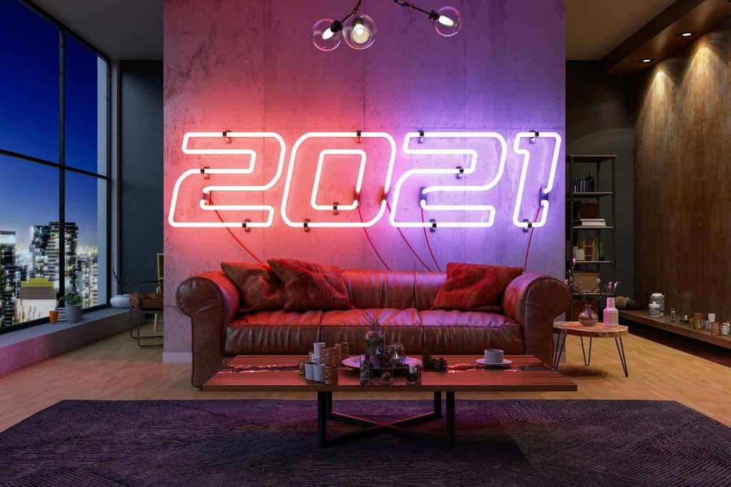 New year concept with 2021 neon light in cozy living room