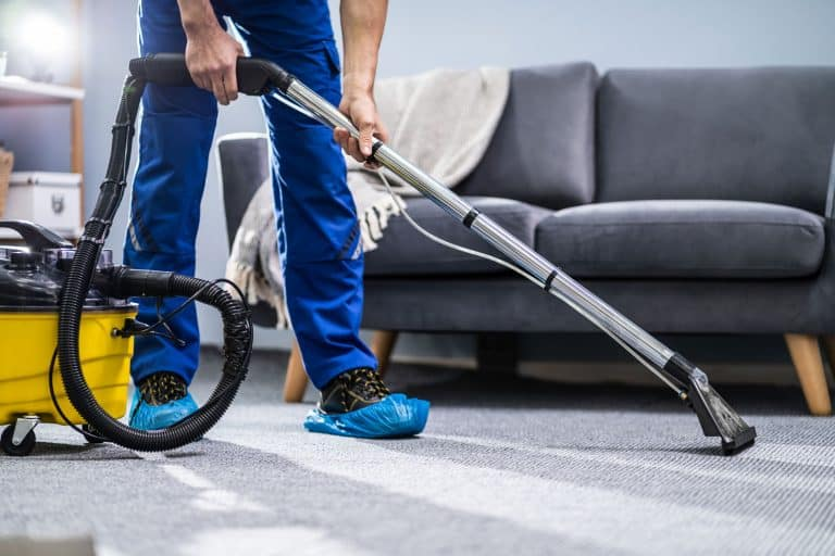 Photo of Janitor Heating a Wet Carpet Using Dry Vacuum cleaner, How To Dry A Wet Carpet [12 Steps]