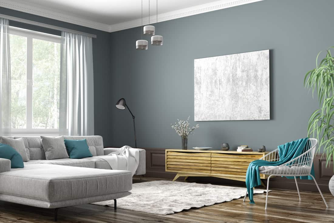Scandinavian apartment, living room with grey sectional sofa, sideboard and white armchair