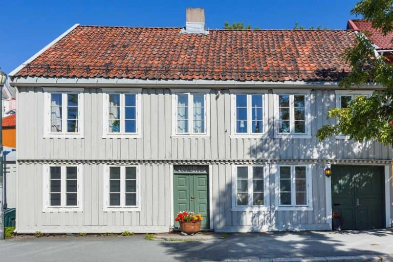 Scandinavian style apartment building with board and batten siding, How Long Does Board And Batten Siding Last?
