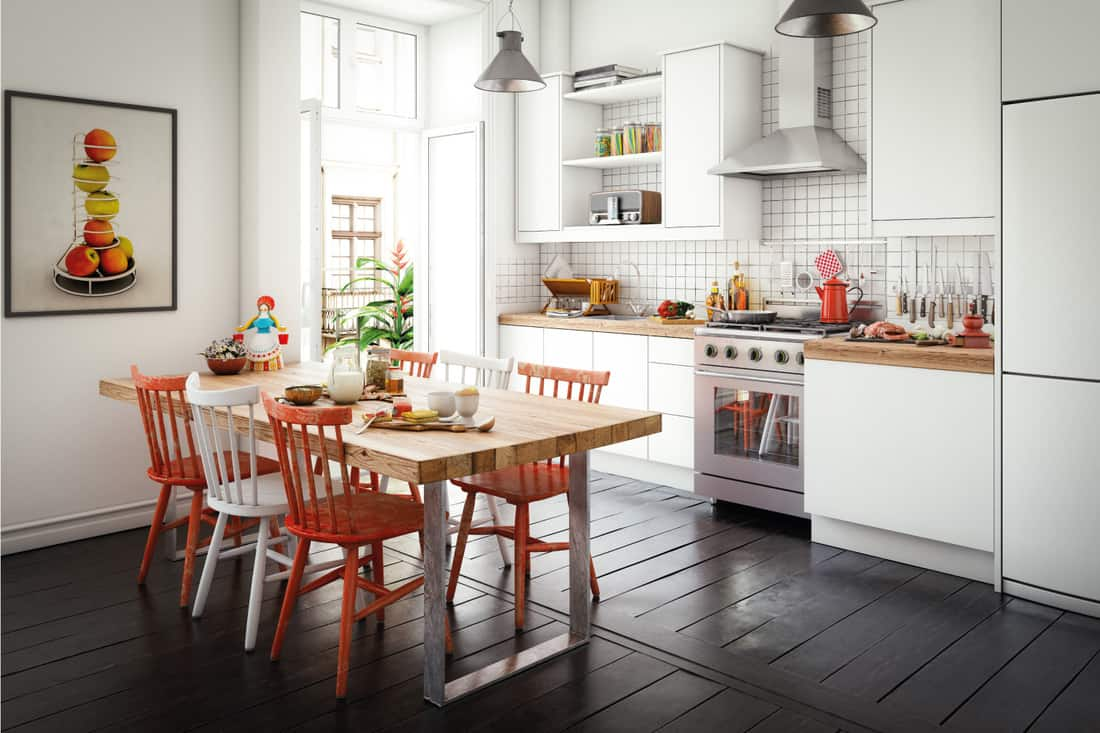 Scandinavian style domestic kitchen interior with a dining table, kitchen counter and lots of props