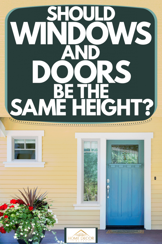 A gorgeous front porch with a blue front door with a small window on the side, Should Windows And Doors Be The Same Height?