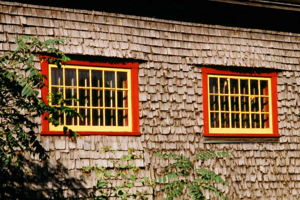 Small house with weathered wooden shingles as sidings