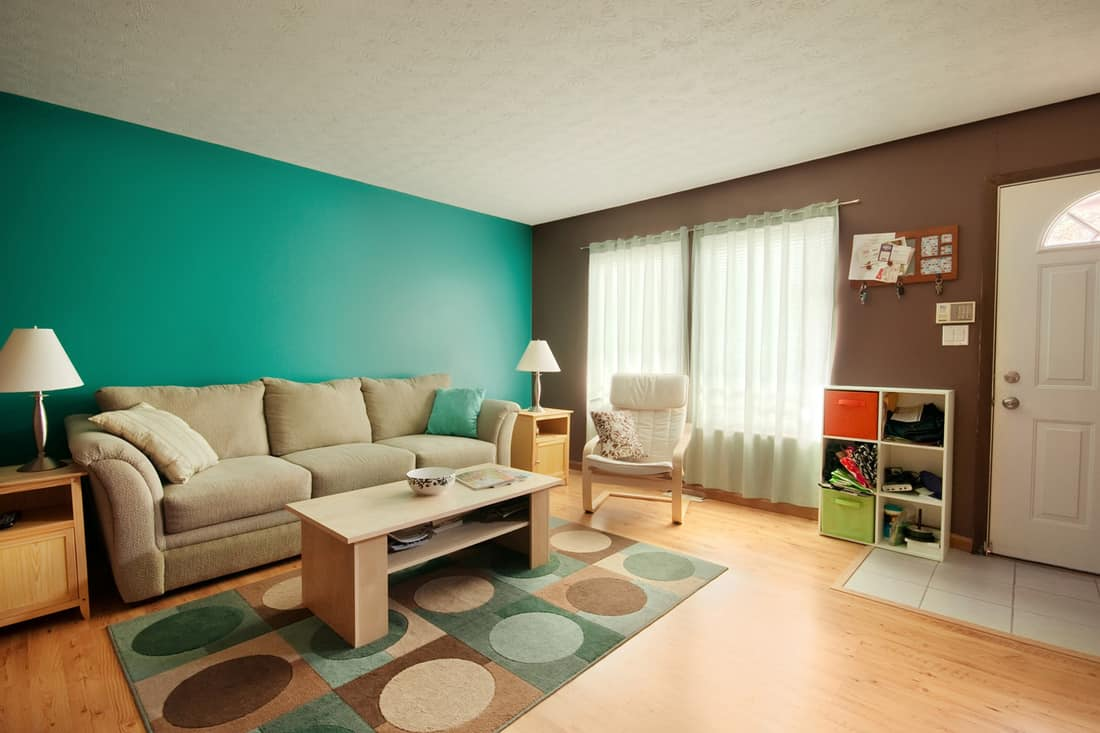 Teal and Brown Family Room with two symmetrical end tables