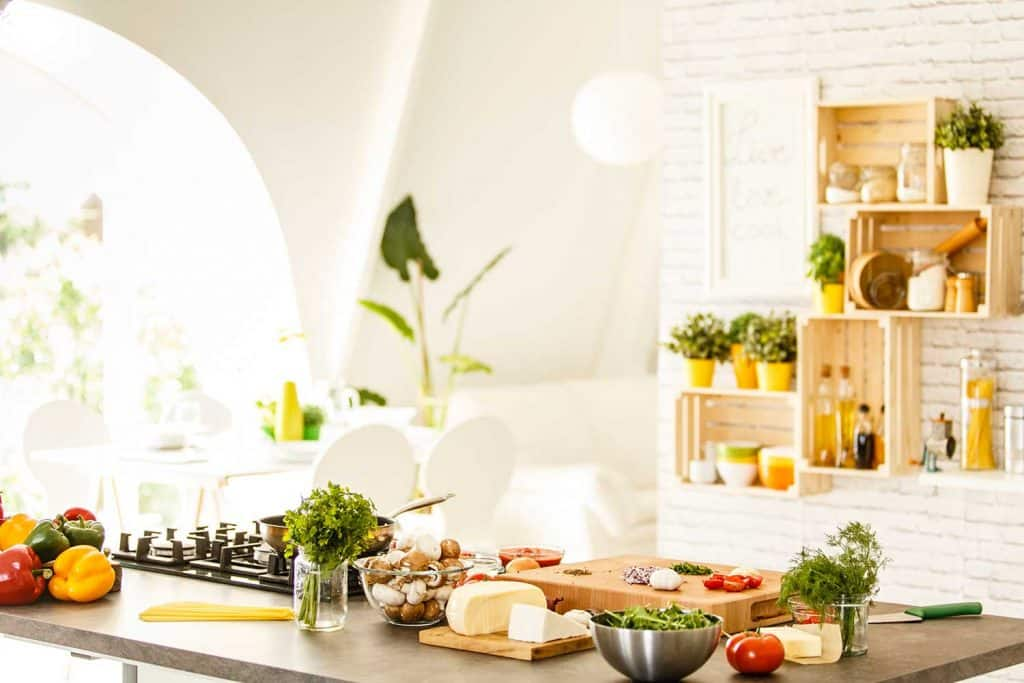 Vegetables, mushrooms and cheese on countertop