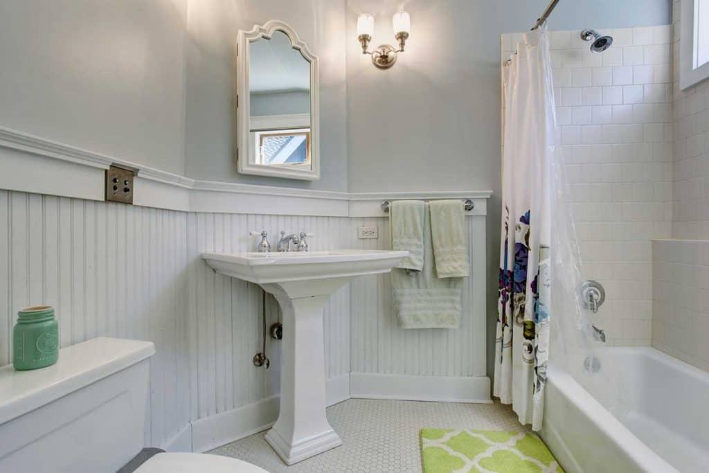Vintage style bathroom with white interior