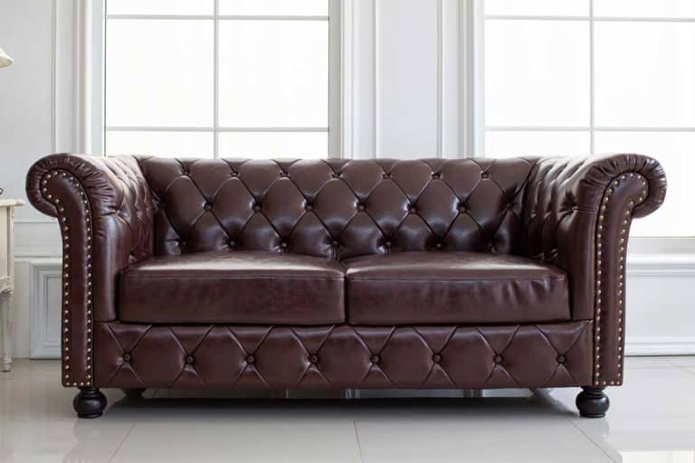 A vintage style of interior decoration the leather sofa in white room, How Long Do Bonded Leather Couches Last