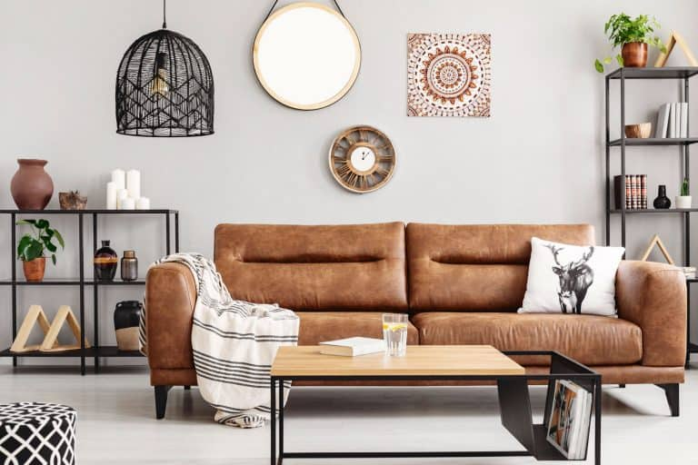 Warm ethno living room with big comfortable leather couch and metal furniture, Does Leather Furniture Have To Match?