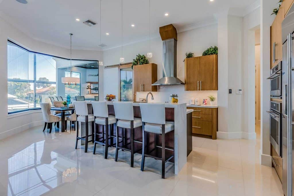 White flooring and brown wood cabinets in luxury home kitchen