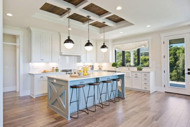 White gourmet kitchen with farmhouse sink and breakfast bar, How To Protect The Wall Under A Breakfast Bar