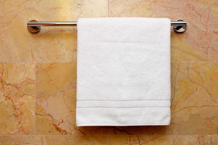 White towel hanged on a towel rack in a modern bathroom, How To Install A Towel Rack [5 Steps]