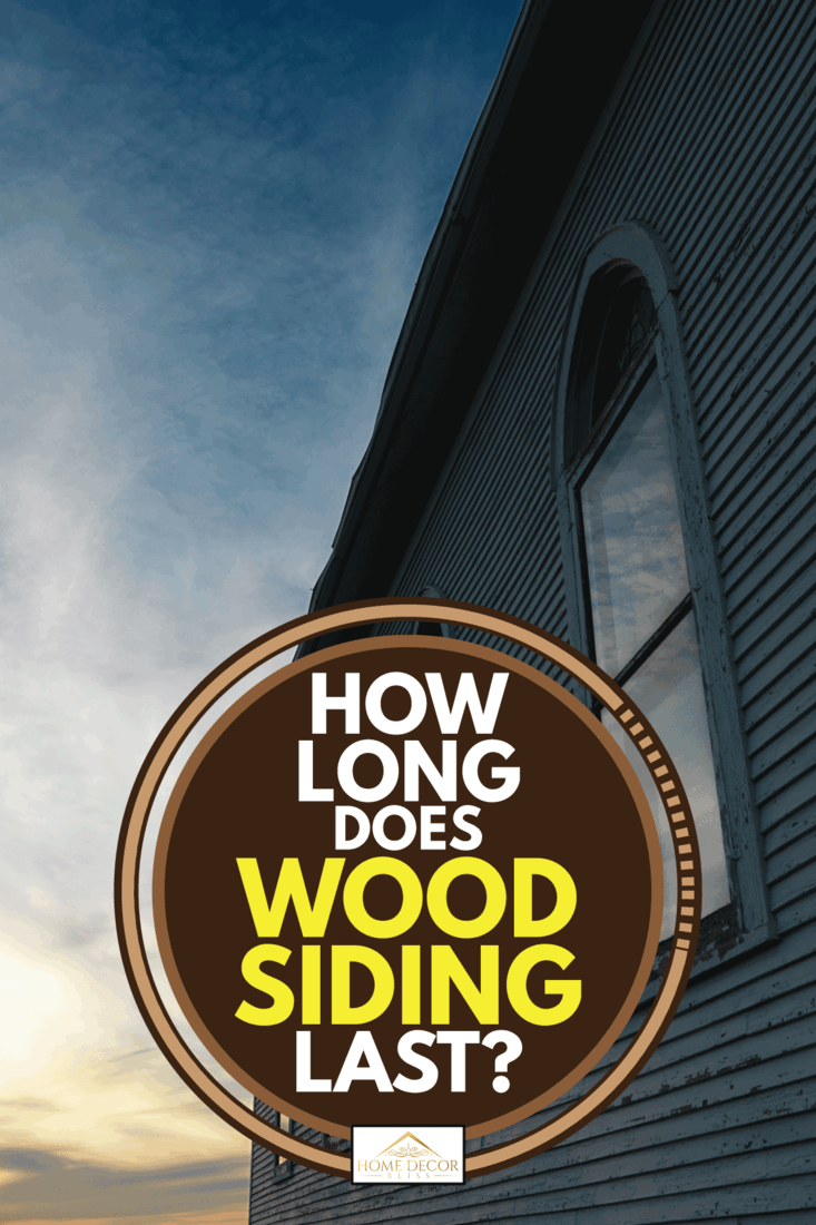 Wooden building with wood siding at sunset, How Long Does Wood Siding Last?