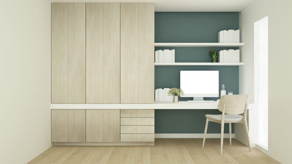 Workplace on green wall design and wardrobe in condominium