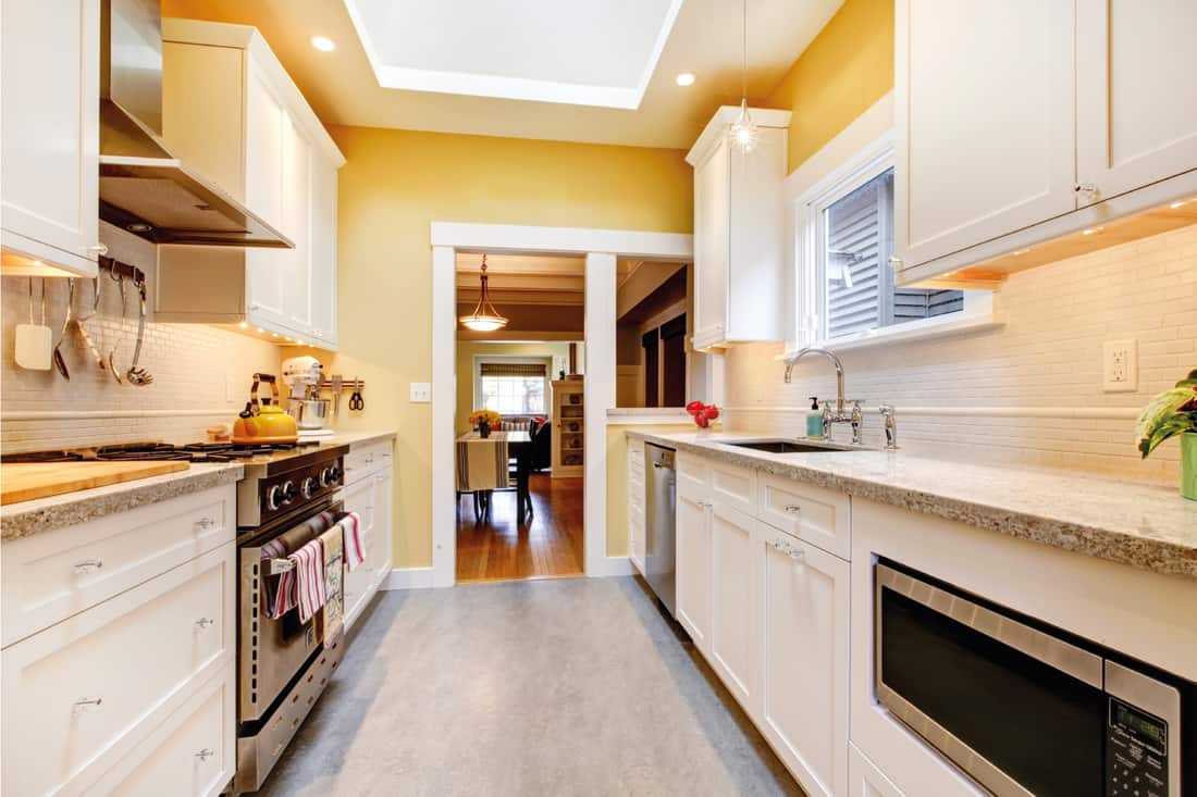 Yellow and white simple kitchen with skylight