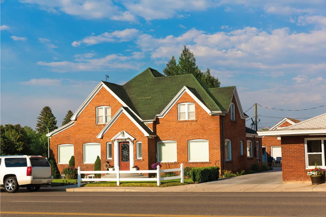 Beautiful cozt red brick house with dark green roof