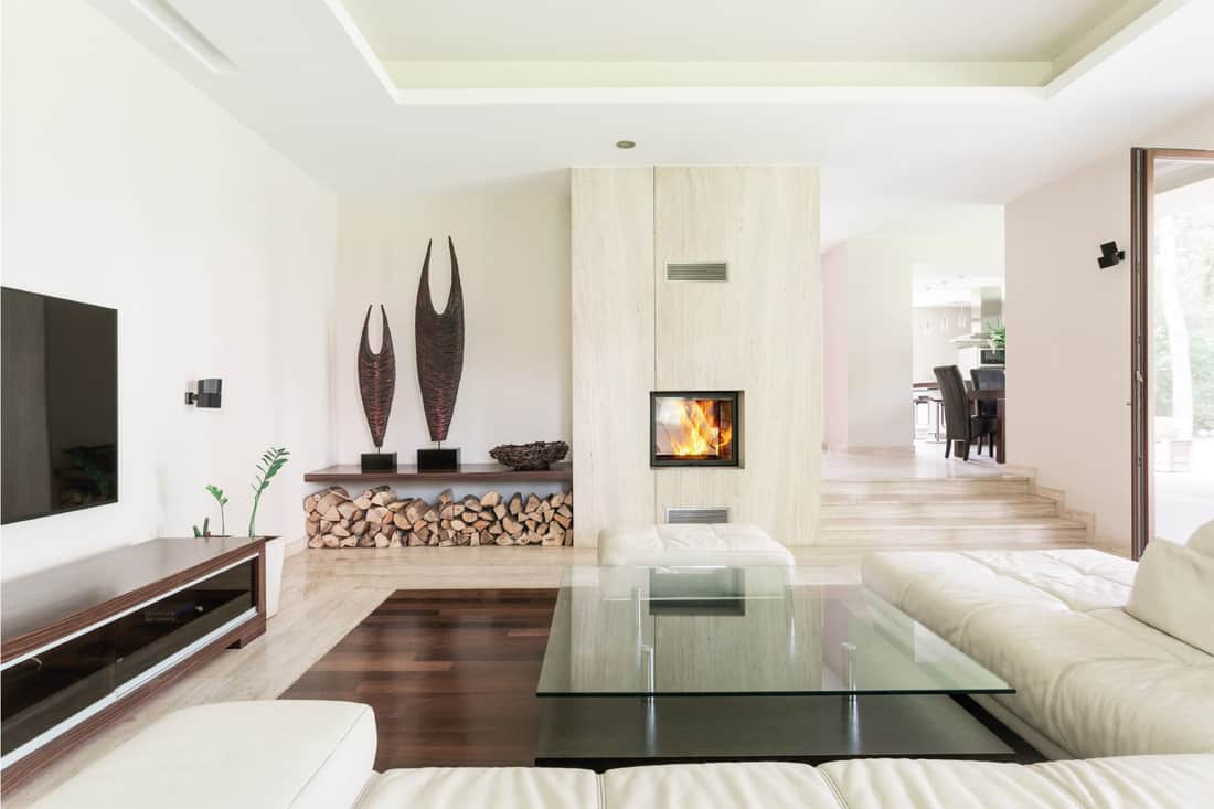 Bright living room with firewood storage on the living room corner