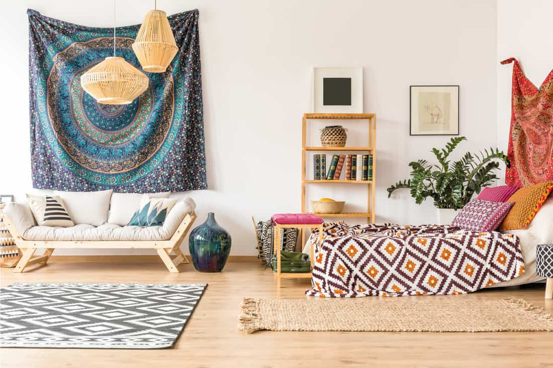California love boho style living room with cloth hung in the wall