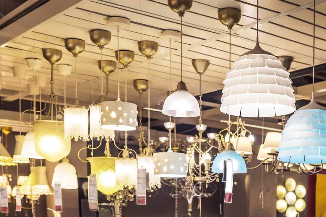 Chandeliers lit and on sale in a store