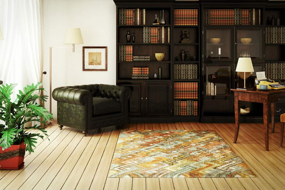 classical home interior (home library) with stylish furniture such as massive bookshelf, home office desk with typewriter