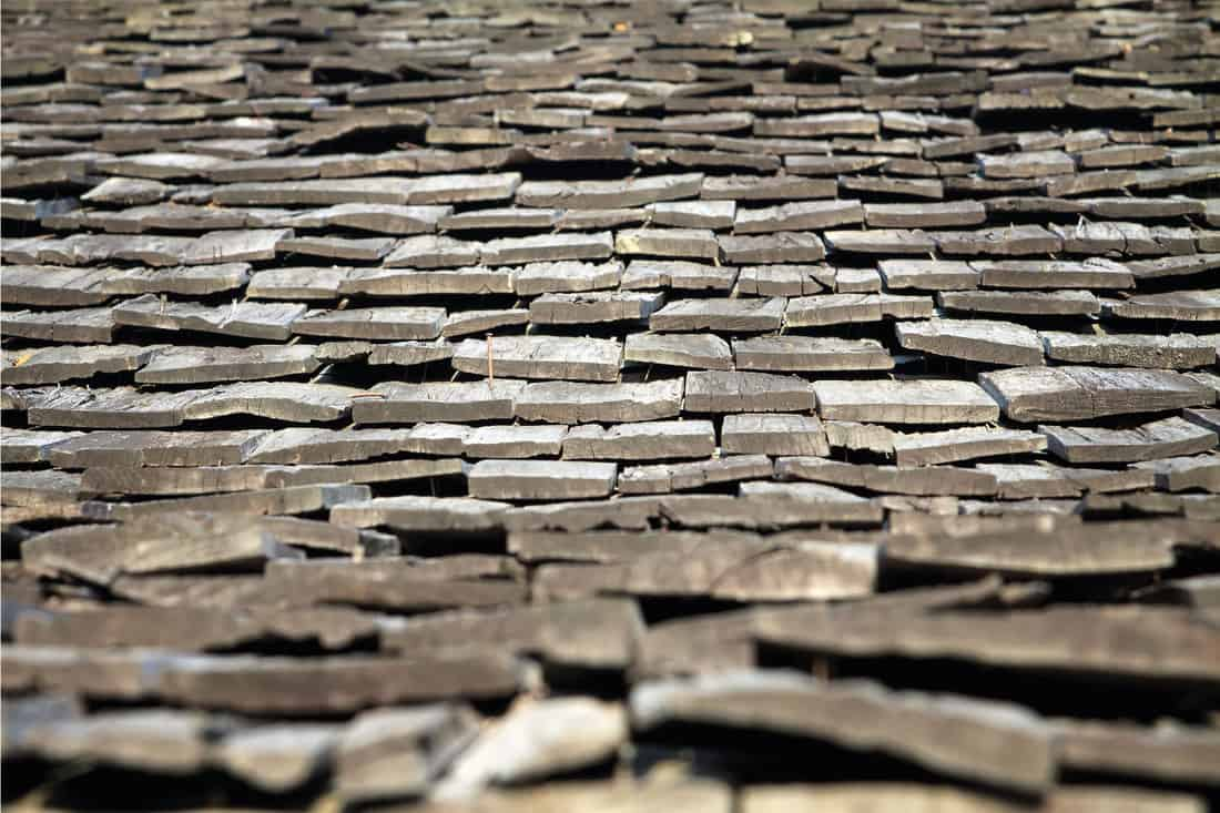 Close up photo of protective wooden shingle on the roof