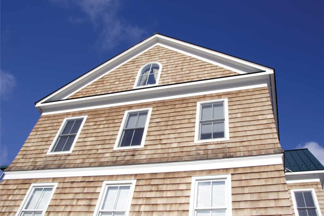 Colonial house front with cedar wood siding