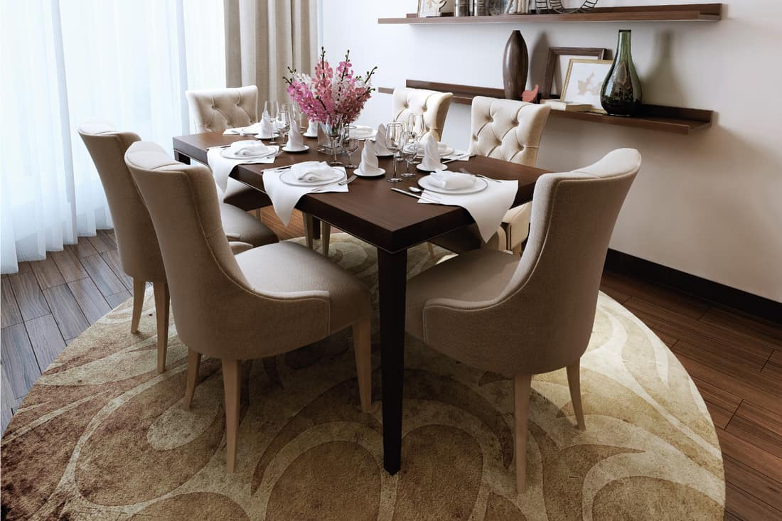 Dining room with elegant furniture and floating cabinets with personal touches