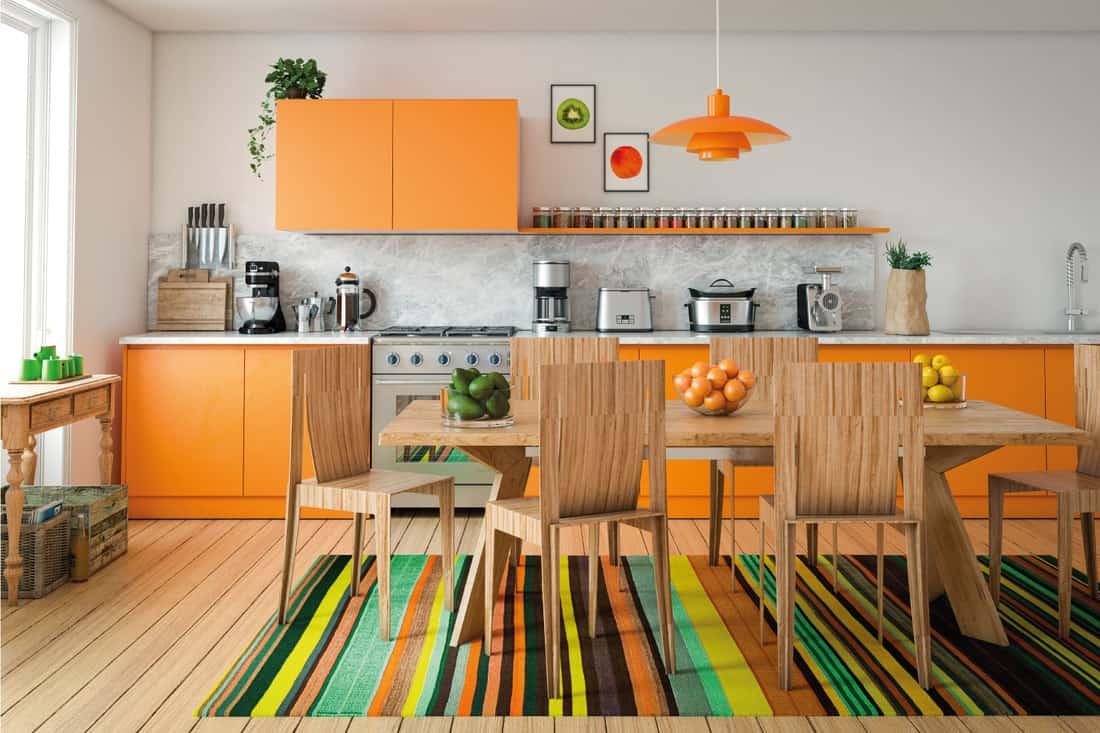 Domestic kitchen interior design with orange cabinets
