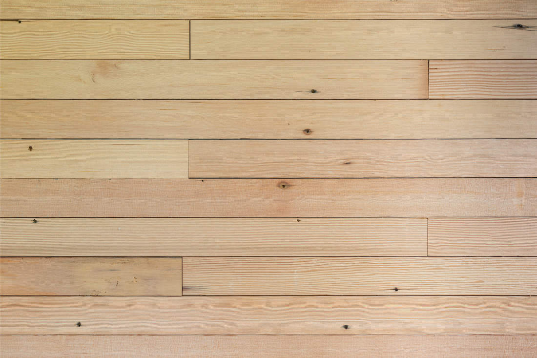 Douglas fir wood panels as wood siding of a home