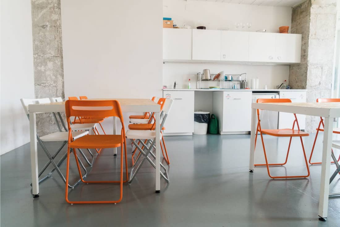 Foldable chairs in a combined kitchen dining area