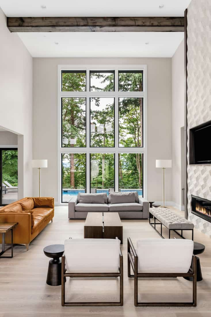 Living room in newly constructed luxury home, furniture arranged to face the windows