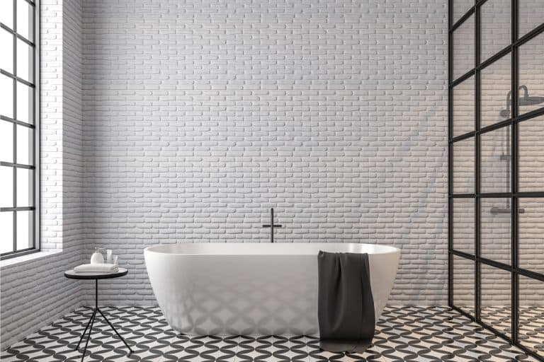 Loft style bathroom, white brick wall, black and white tile floor pattern, 11 Fantastic Bathroom Wall Tile Ideas