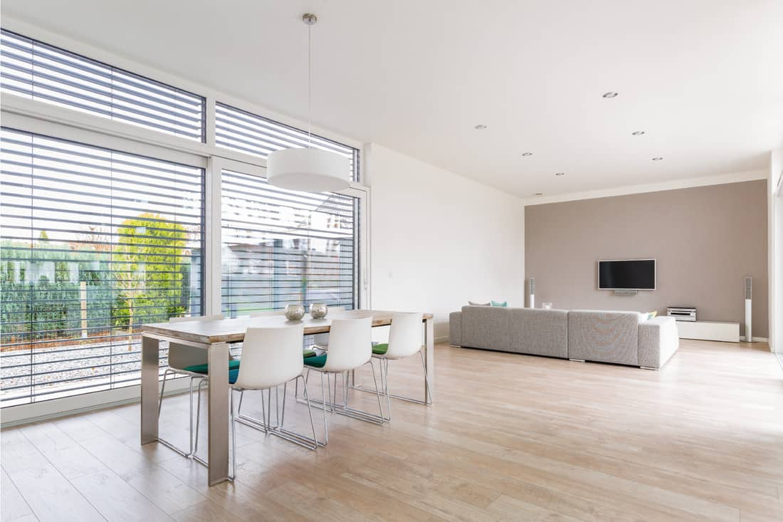 modern bright dining-room with large windows with broad blinds