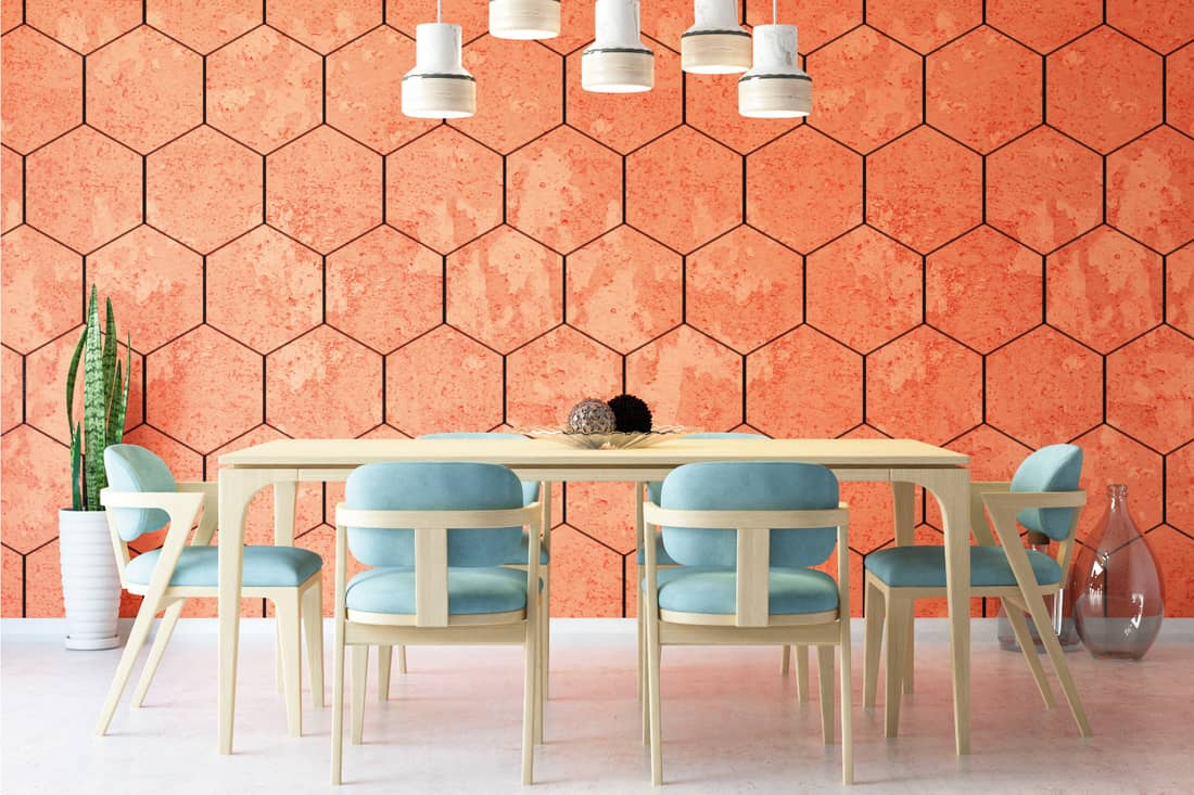 Modern dining room with geometric shapes like hexagons wallpaper, pendant lights and light colored wood furniture