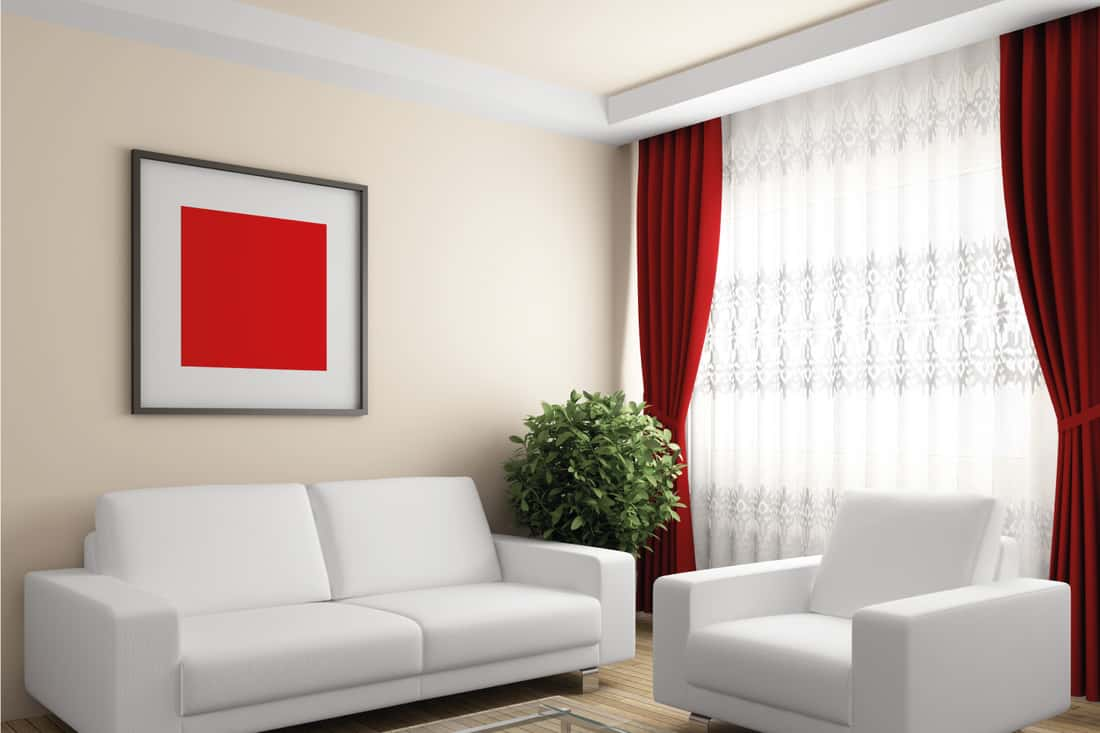 Modern living room with white furniture and red curtains