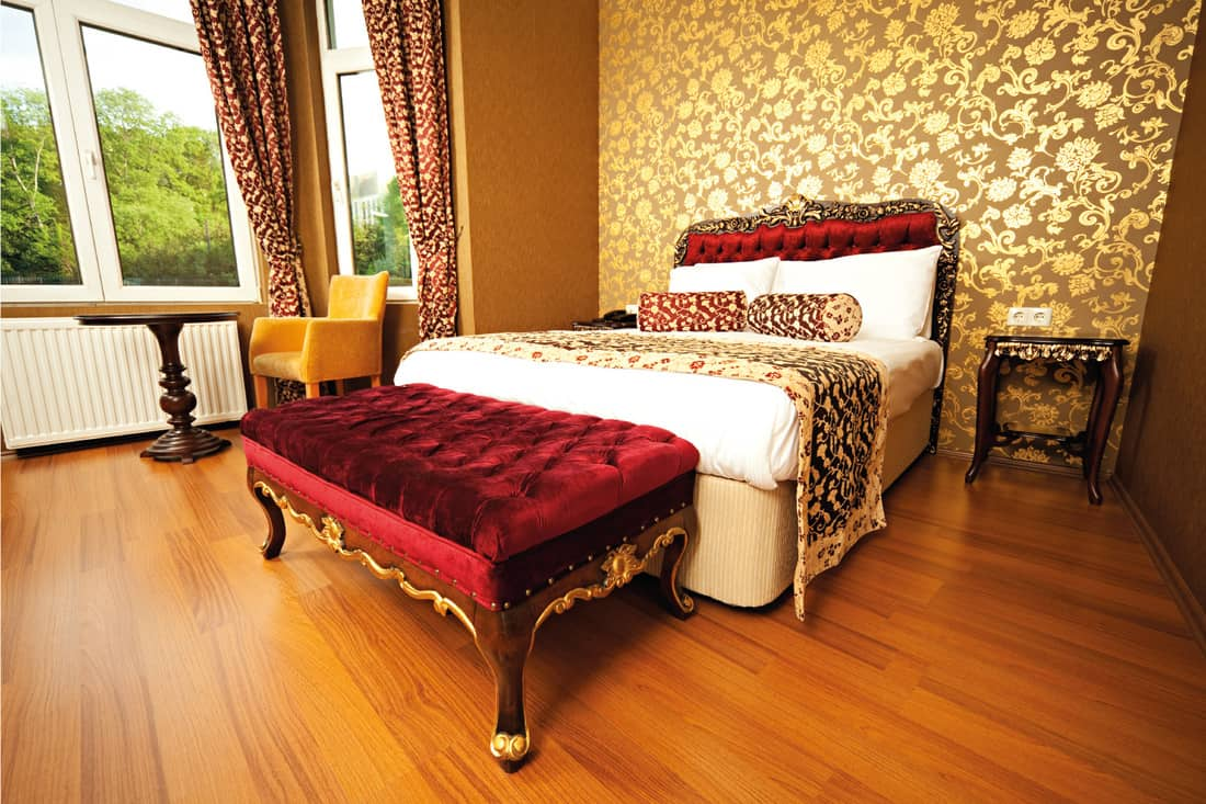 Oriental hotel room with red and gold curtain and accents