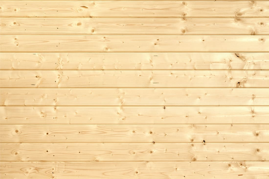 Pine wood panels installed as wood siding
