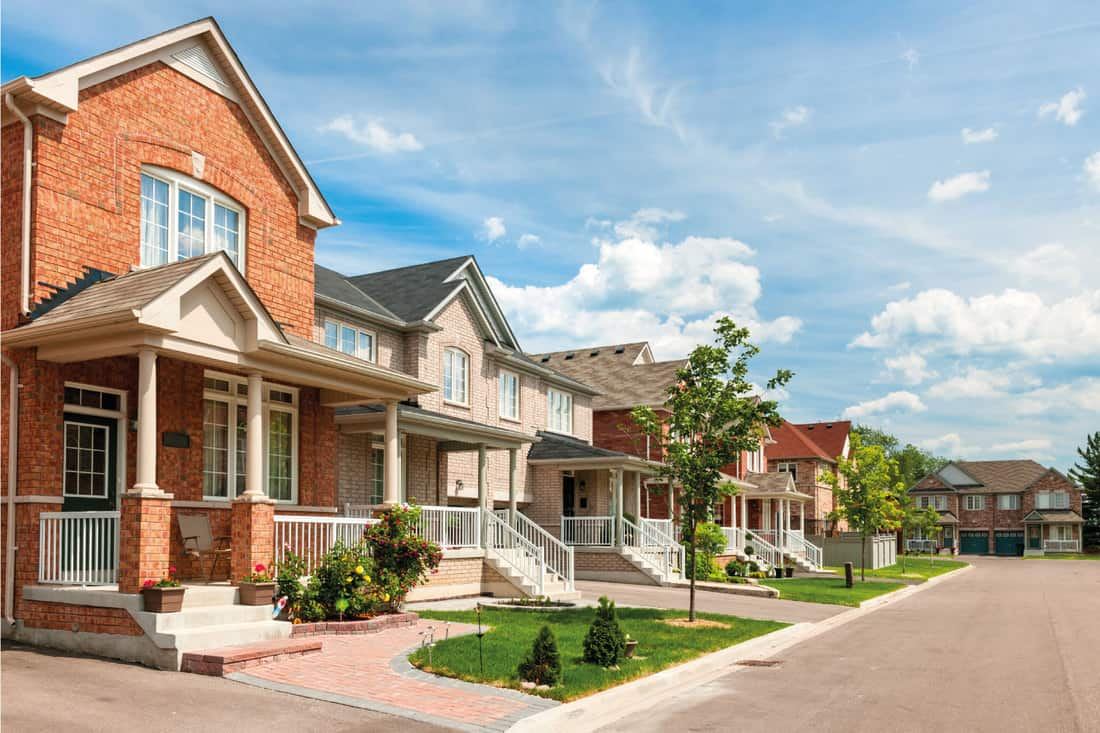 Red brick suburban homes in a row