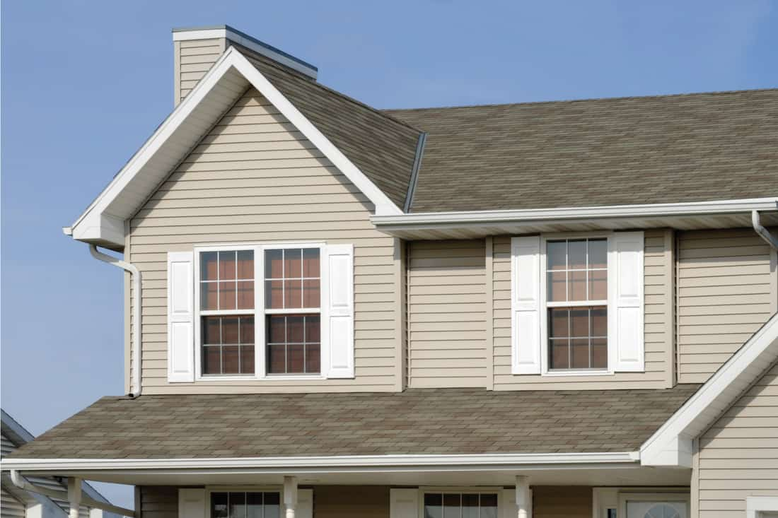 Architectural asphalt shingle roof, vinyl siding, windows, vinyl shutters, and seamless aluminum gutters