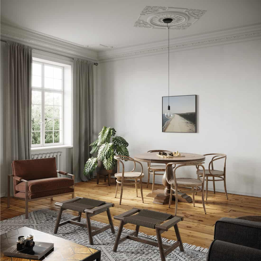 small playing table for four in a living room with tab curtains in the windows
