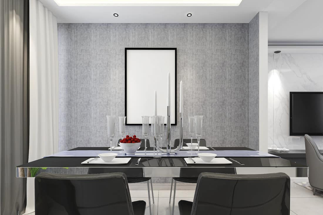Spacious dining room design next to the modern kitchen, with a beautiful dining table and greenery