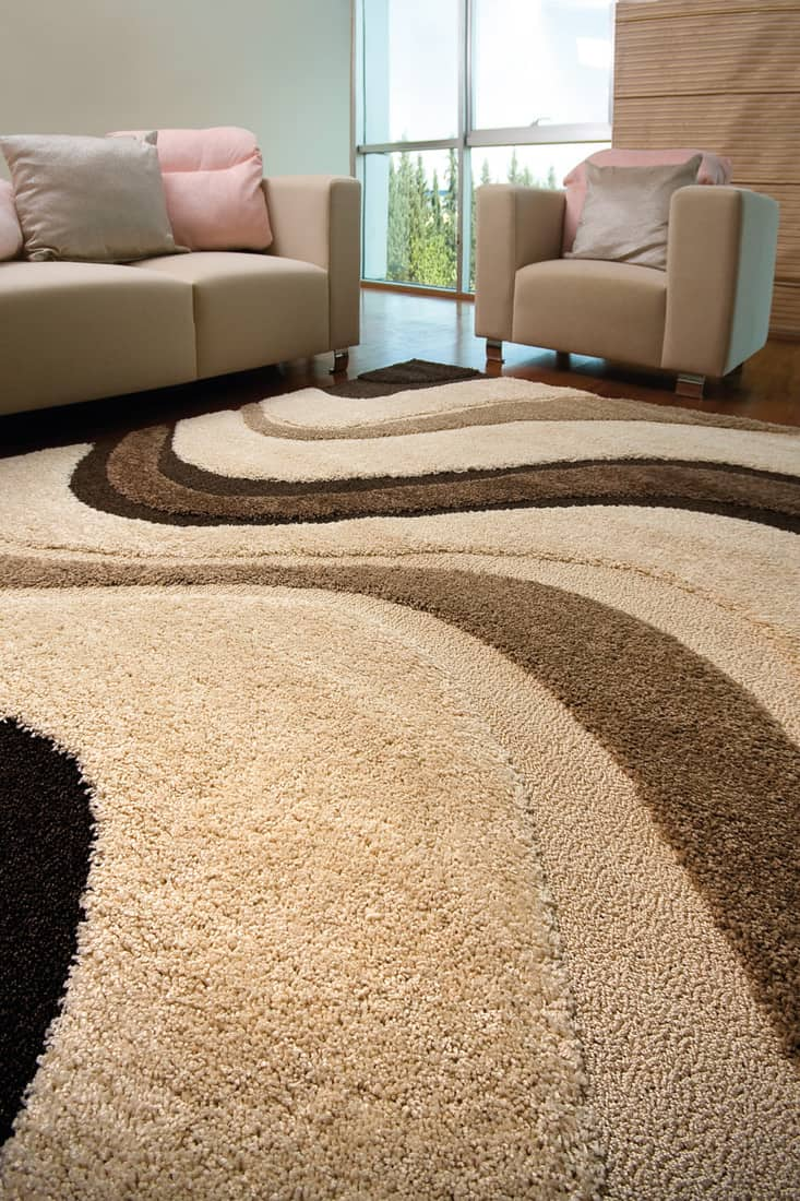 Taupe carpet in living room with light brown sofa