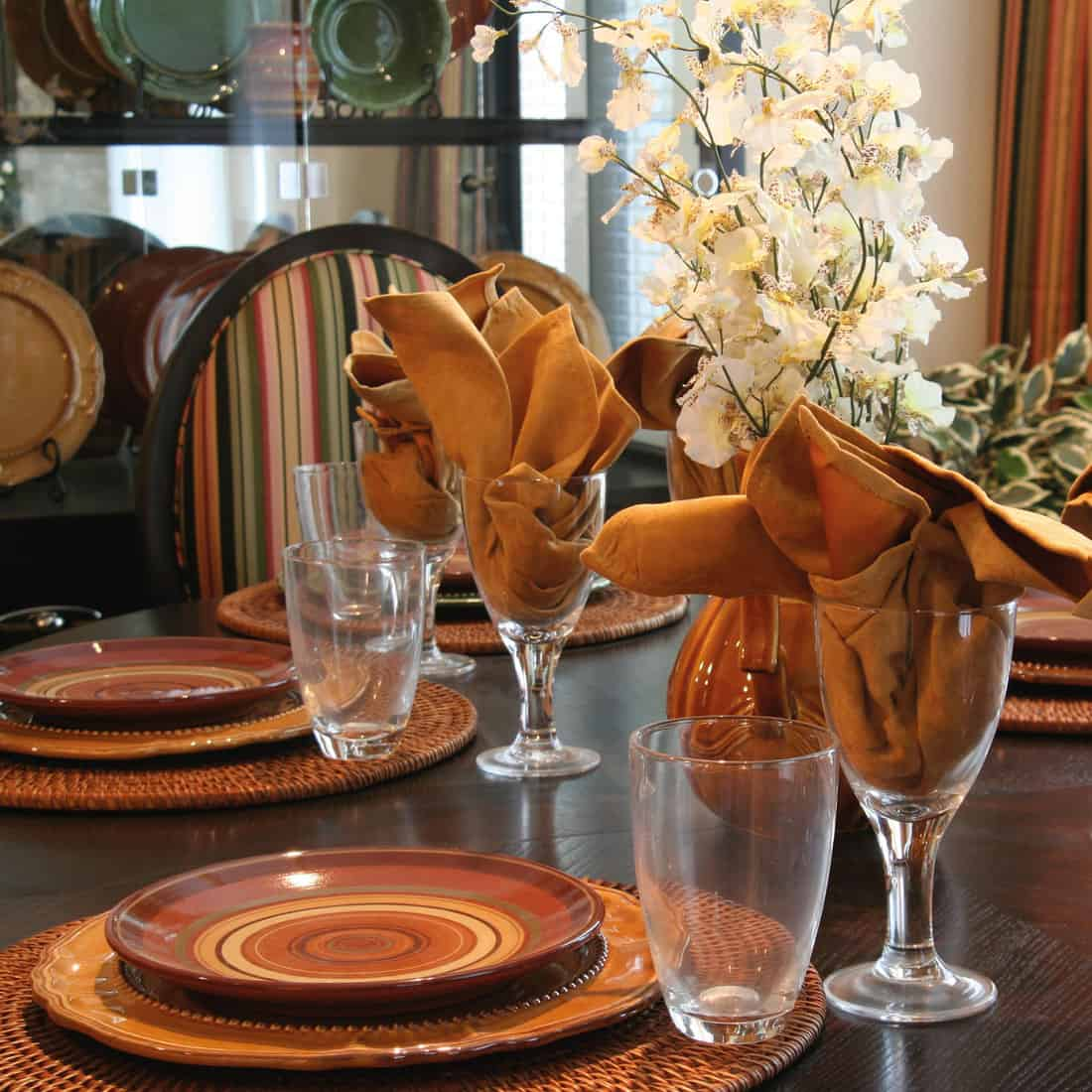 thanksgiving table setup with round shaped placemats
