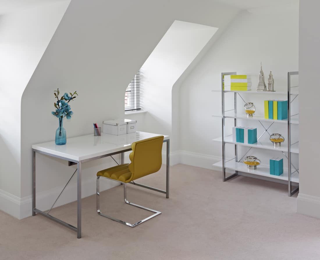 the office or study area in a bedroom in an attic of a new home