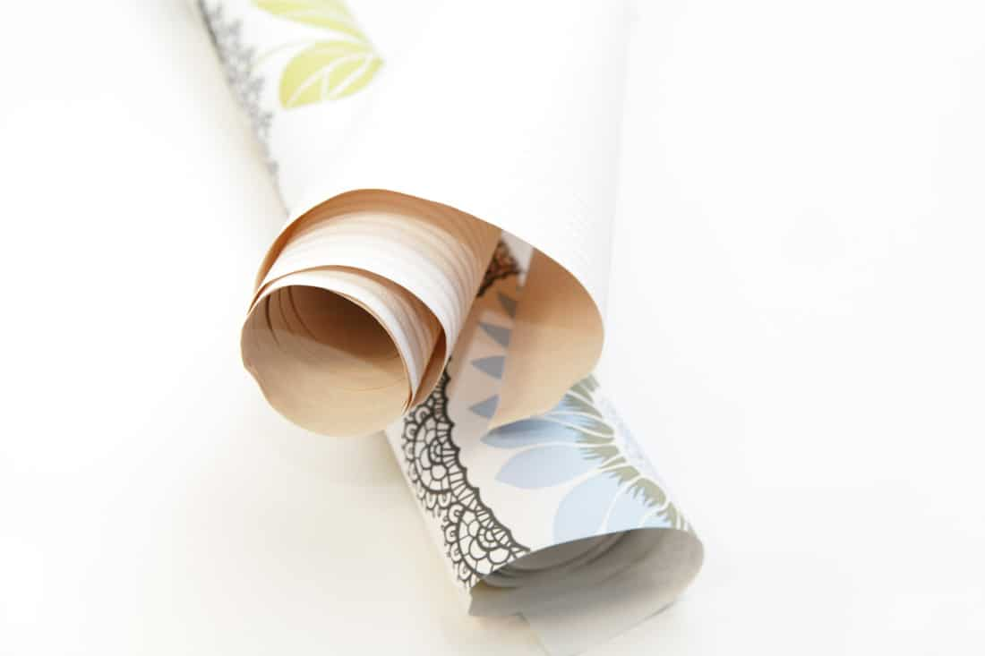 Two rolls of temporary wallpaper rolled up