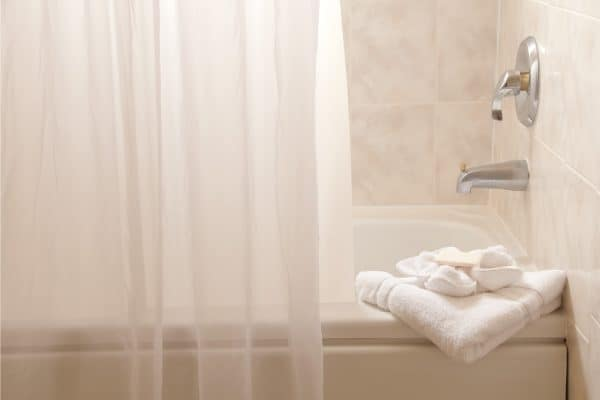 How To Hang A Shower Curtain [Even Without Hooks]